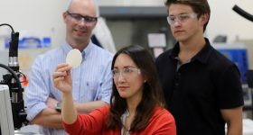 (From left) LLNL researchers ) Ward Small, Amanda Wu and Taylor Bryson examine a wafer of 4D silicone material. LLNL photo by Carrie Martin.