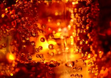 Carbonated cola bubbles with ice. Photo via Shutterstock