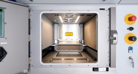 Inside the build chamber of an SLM Solutions SLM280 2.0 machine. Image via SLM Solutions