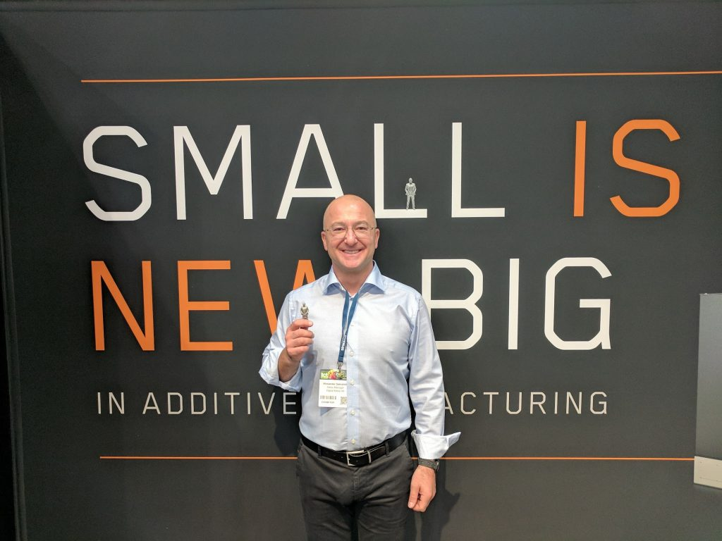 Alexander Sakratidis Sales Manager at Digital Metal holding his 3D printed likeness. Photo by Michael Petch.