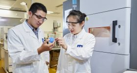 BASF researchers inspect a 3D print. Photo via BASF.