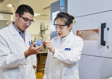 BASF researchers inspect a 3D print. Photo via BASF.