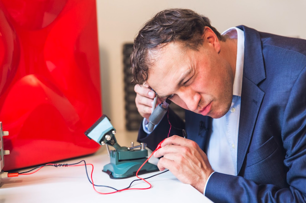 Herold works on the smart-glasses with a frame printed using a Sinterit Lisa AR. Photo via Sinterit.