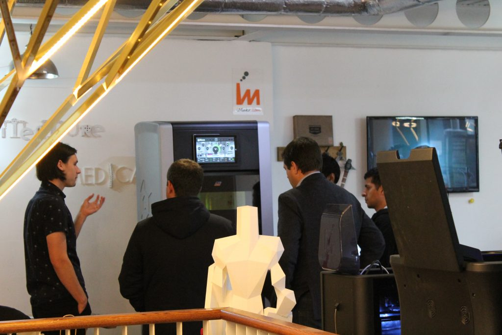 Customers check out iMakr's latest stock, the ORLAS CREATOR, in the store in Farringdon. Photo by Tony Arnaud