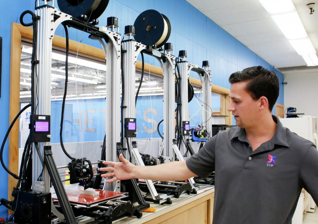 Josh Teigen, president and chief visionary of Protosthetics, shows some of the company's own 3-D printers Thursday, May 11, 2017, in their Fargo lab. Michael Vosburg / Forum Photo Editor