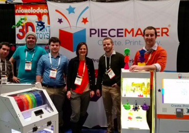 The PieceMaker team at their New York toy printing on demand fair booth. Photo via Twitter/@PieceMakerTech