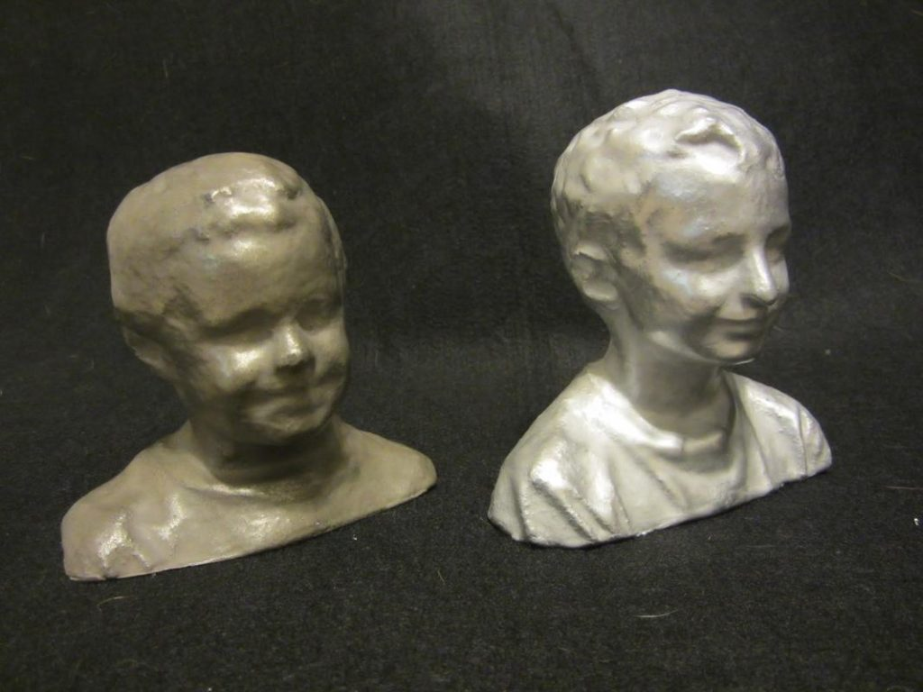 AMClad used to 3D print busts of the children of Freshmade 3D's Christopher Tomko. Photo via Freshmade 3D.