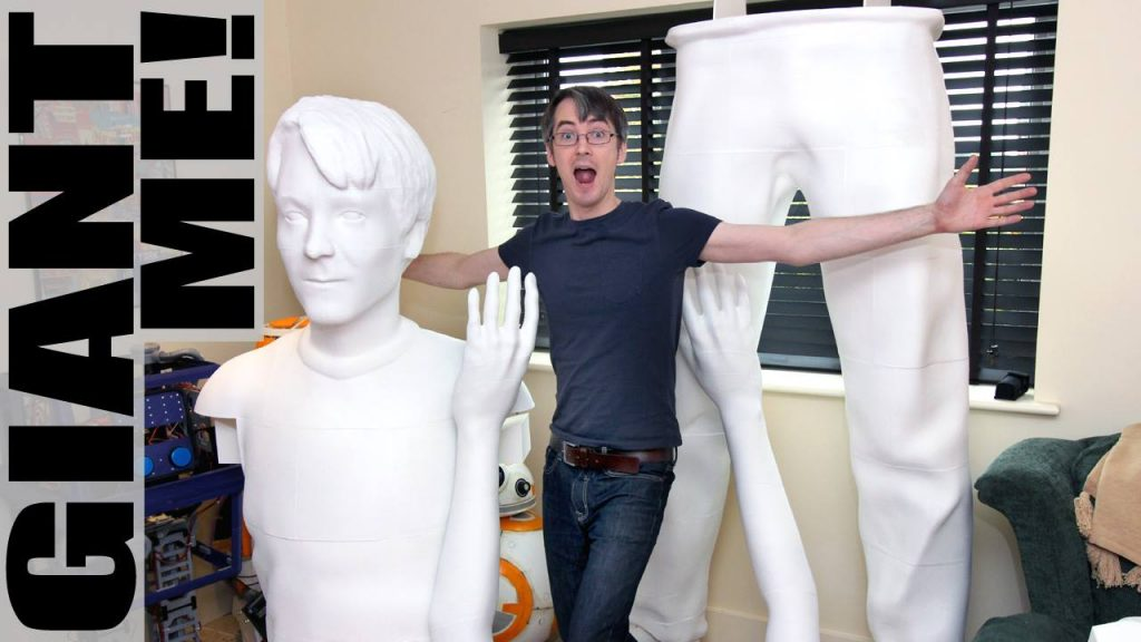 James Bruton next to pieces of the giant version of himself. Photo via XRobots.
