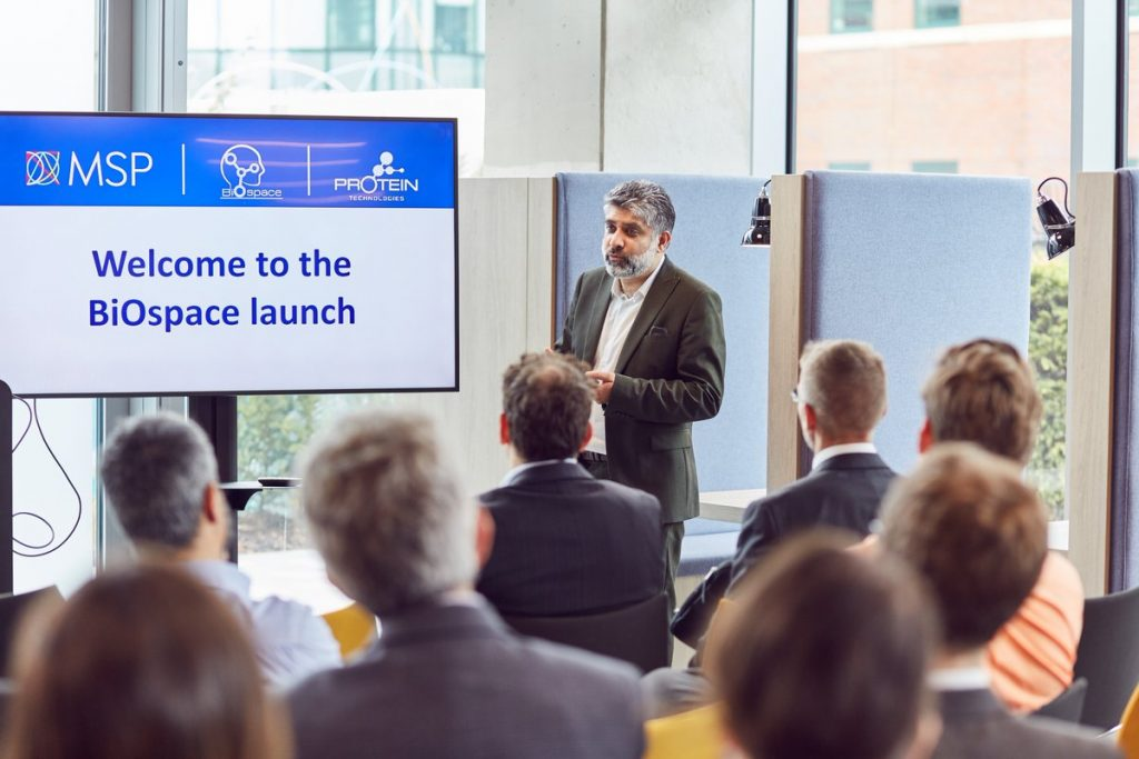 Dr. Farid Kahn, co-founder of BiOspace and chair of Protein Technologies Ltd. shows visitors around the new facility at Manchester Science Park. Photo via BiOspace UK