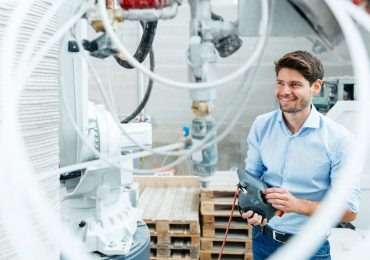 Overtec CEO Sebastian Hillscher with Overtec's 3D printer and a printed structure. Photo via Overtec.