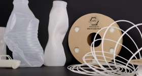 A recycled Refil filament spool with empty yoghurt pots and examples of what can be printed from it them. Photo via Refil.