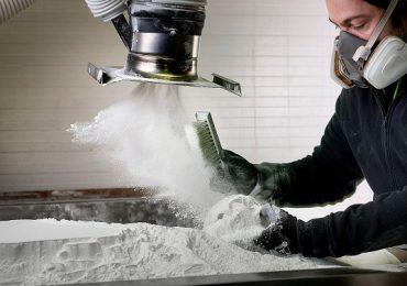 Removing 3D printed parts from the excess powdercake in a polymer sintering system. Photo by Photo by Arthur Los, Milo-Profi studio. Copyright by Flanders Investment & Trade via imaterialise