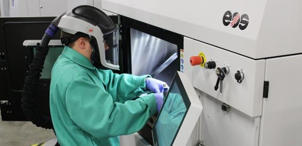 Powder handling in an EOS machine. Photo via UL