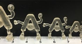 3D printed samples of the Ames Lab logo. Image via ACS Catalysis.