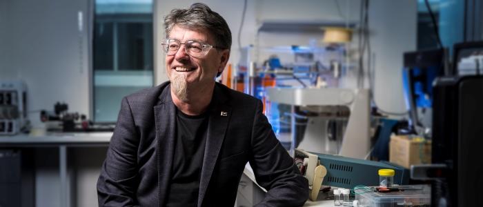 Prof. Gordon Wallace, Order of Australia, in his lab. Photo via ACES.