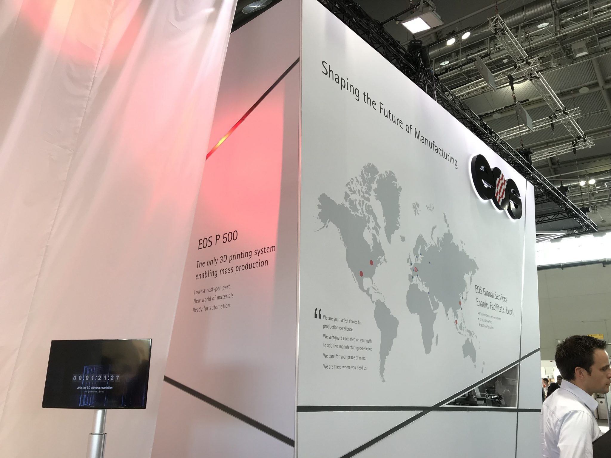 The EOS booth pre-runveiling of the new P500 machine. Photo by Beau Jackson for 3D Printing certification Industry
