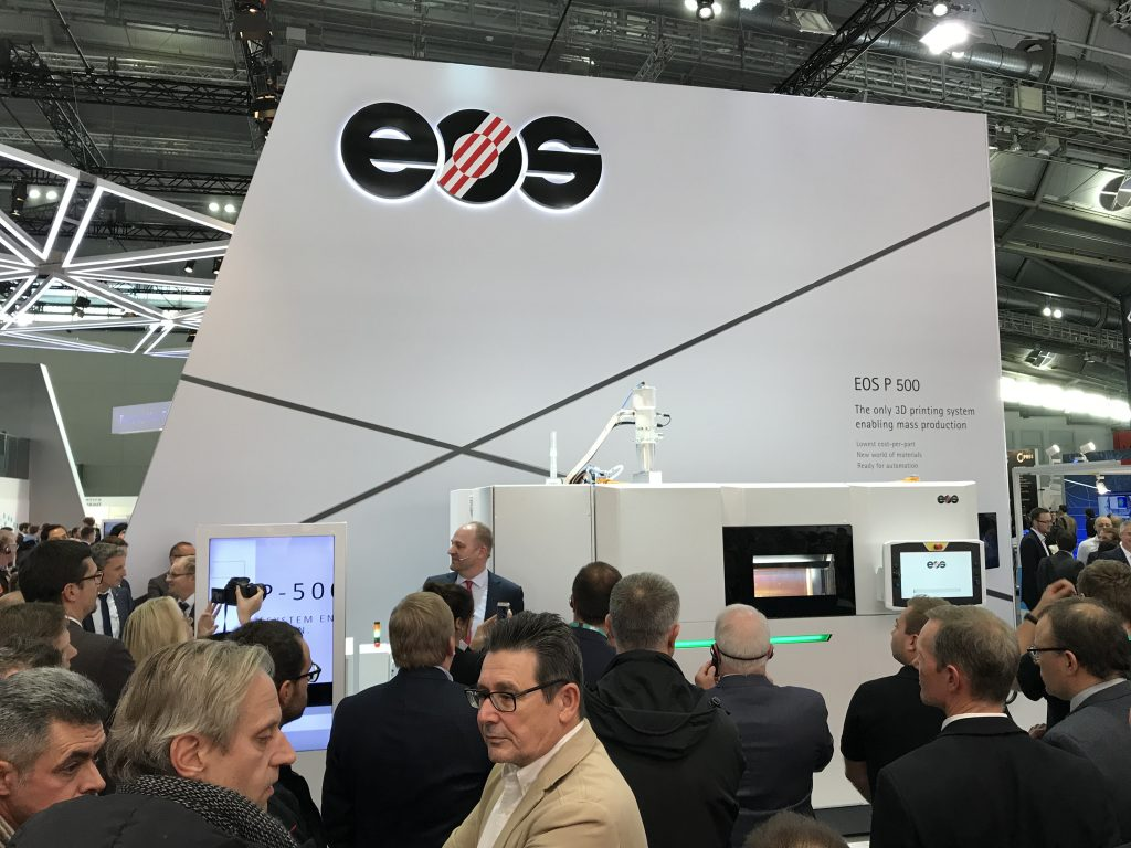 A crowd forms around for the unveiling of the EOS P500 machine led by CTO Tobias Abeln.