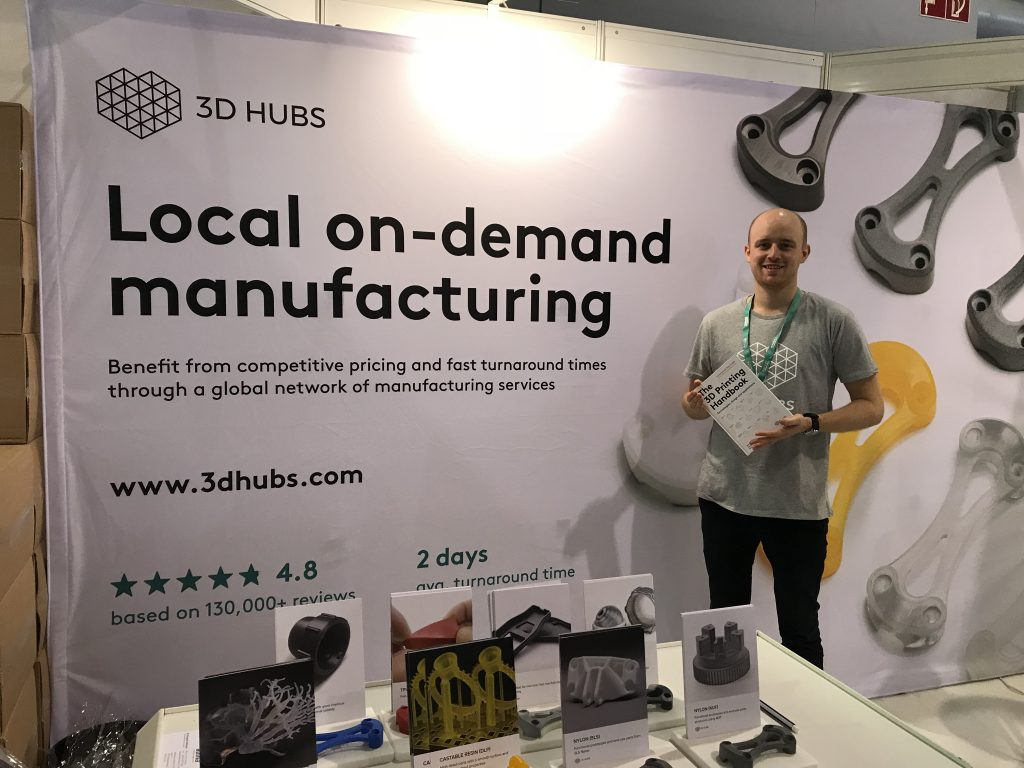 George holds the 3D Printing Handbook at 3D Hubs booth. Photo by Beau Jackson for 3D Printing Industry