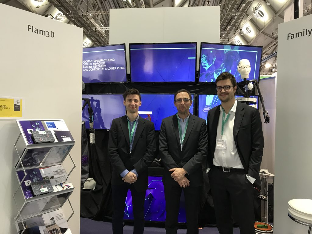 The Flam3D team stand beside their Family of th Future. Photo by Beau Jackson for 3D Printing Industry
