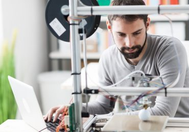A designer using CAD and 3D printing in the laboratory. Photo via SelfCAD.