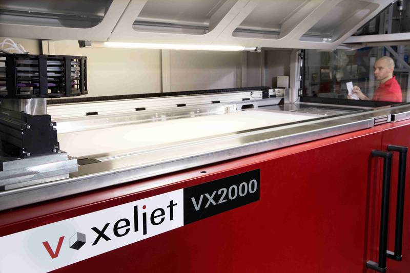 Under the hood of the VX200 industrial 3D printer. Photo via voxeljet