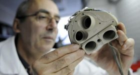 A CARMAT technician inspecting an artificial heart. Photo via AFP.