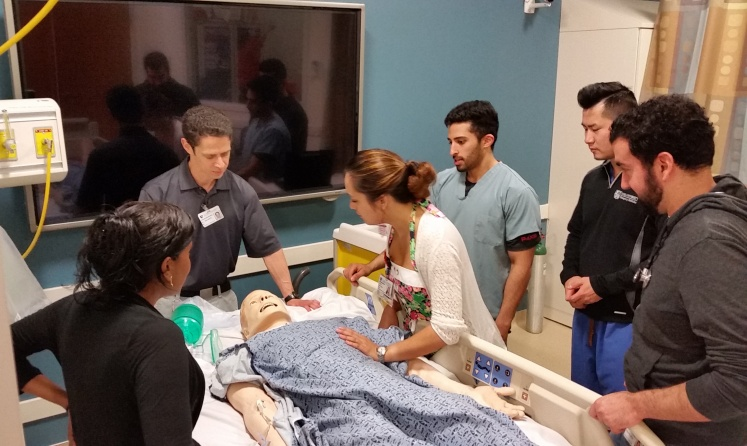 Broder teaching students. Photo via Duke Health.
