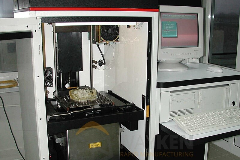 SLA 3D printing system. Photo via WayKen
