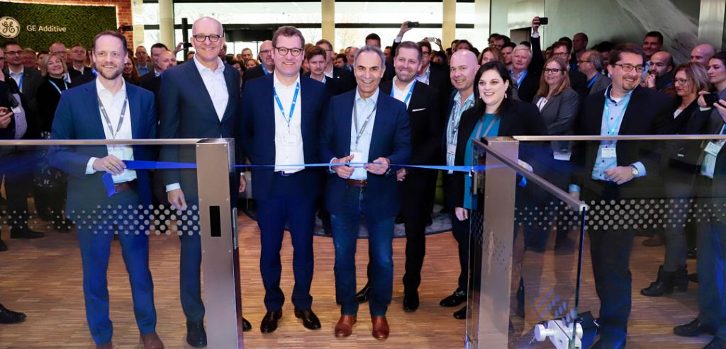 Mohammad Ehteshami, Vice President & General Manager GE Additive, cuts the ribbon to officially open Munich's Customer Experience Center. Photo via GE Additive