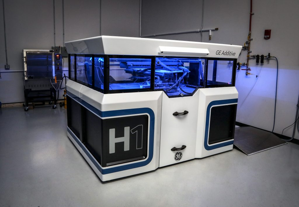 The prototype H1 binder jet 3D printer from GE Additive. Photo via GE