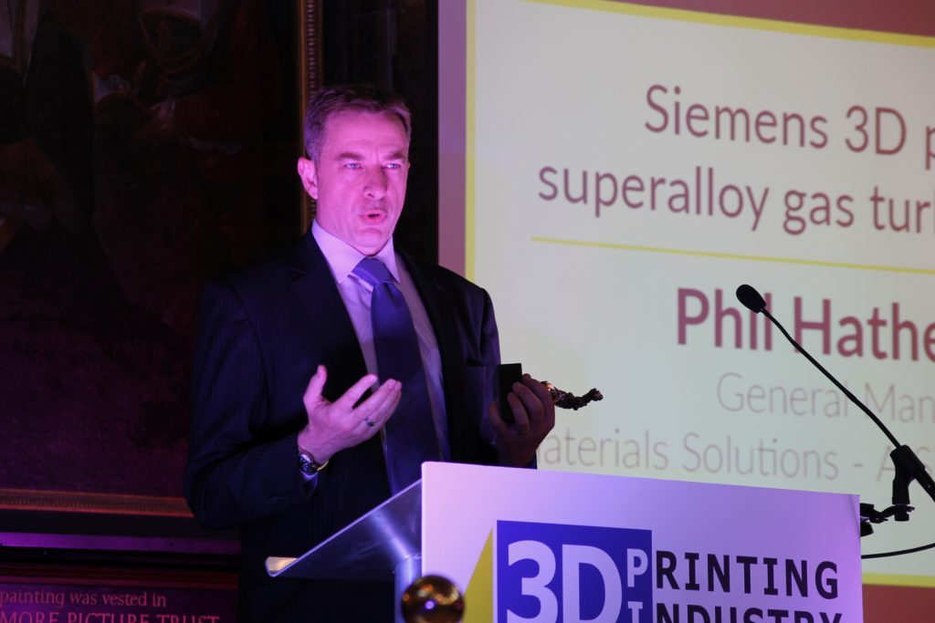 Phil Hatherley, General Manager, Materials Solutions – A Siemens Business, accepts the award for the 3D printed superalloy gas turbine blades at the 3D Printing Industry Awards 2017. Photo by Antoine Fargette for 3D Printing Industry.