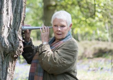 Dame Judi Dench listens to water rising through the bark of an oak tree in Judi Dench: My Passion for Trees on BBC One Photo by Gary Moyes