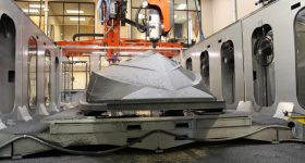 Machining the 3D printed hull pattern on Thermwood's LSAM system. Photo via JEC Group