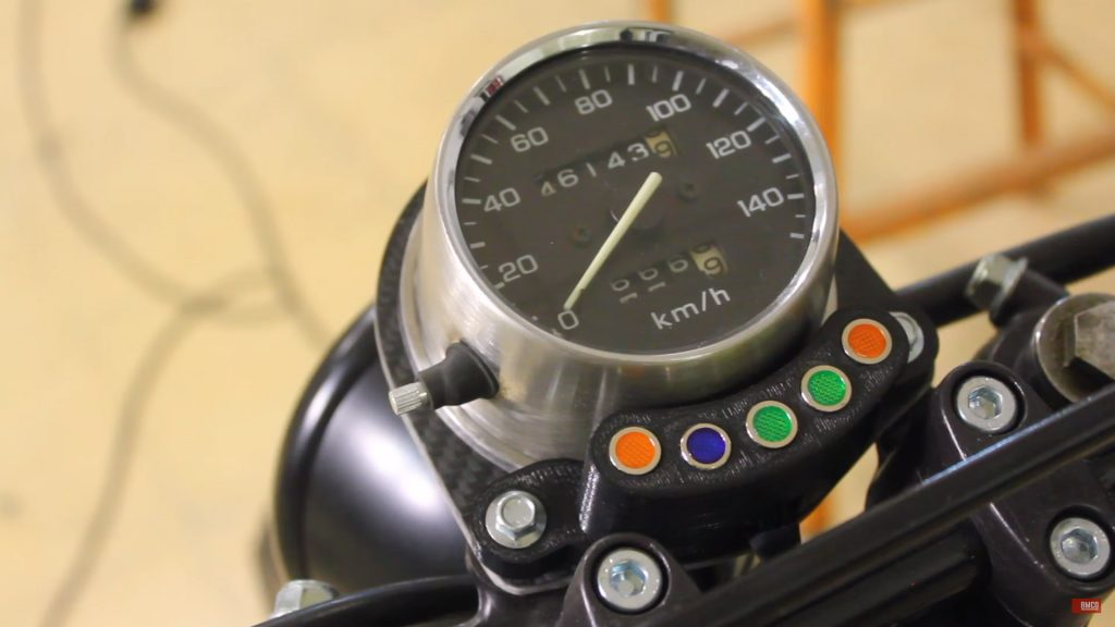 A custom 3D printed light housing for the dash of a Honda CB 250. Screengrab via BMCO on YouTube
