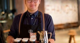 A barista serving tea in the new Starbucks Reserve Roastery Shanghai. Photo via Starbucks