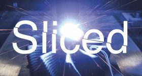Sliced logo over GEFERTEC's wire arc additive manufacturing process. Photo via GEFERTEC