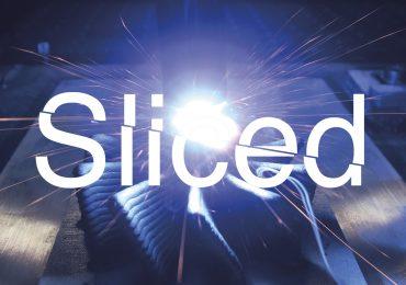 Sliced logo over GEFERTEC's wire arc additive manufacturing process. Photo via GEFERTEC