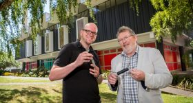 Dr Tim Huber (left) and Professor Conan Fee hold their prizewinning 3D printed heat exchangers. Photo via University of Canterbury