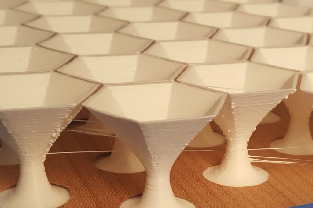 3D printed sculptural forms combined with laminated plywood. Photo via Catalano Design