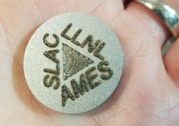 SLAC, LLNL and AMES logo DED 3D printed on a sample. Photo by Johanna Nelson Weker/SLAC