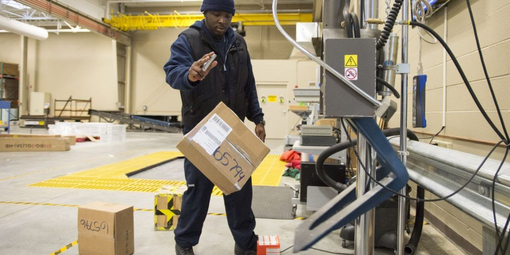 Drop test of a parcel at FedEx Packaging Lab. Photo by Wayne Risher/The Commercial Appeal