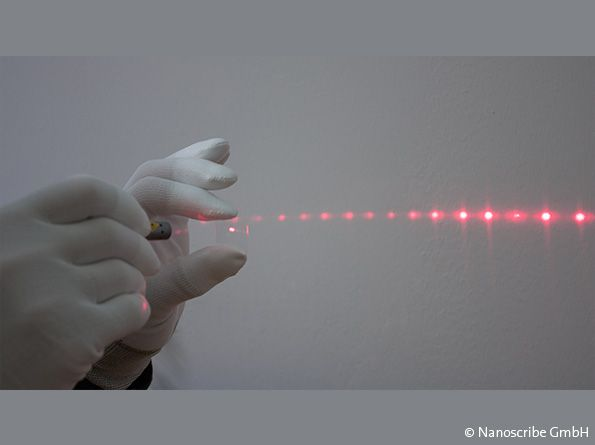 """Multifocal diffraction pattern generated by a red laser pointer passing though a diffractive optical element (DOE)."" Photo and caption via Nanoscribe GmbH"