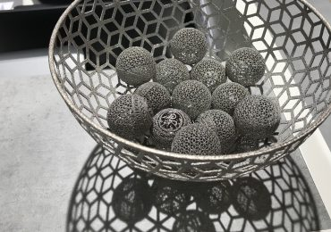 A bowl of metal 3D printed GE-spheres. Photo by Beau Jackson