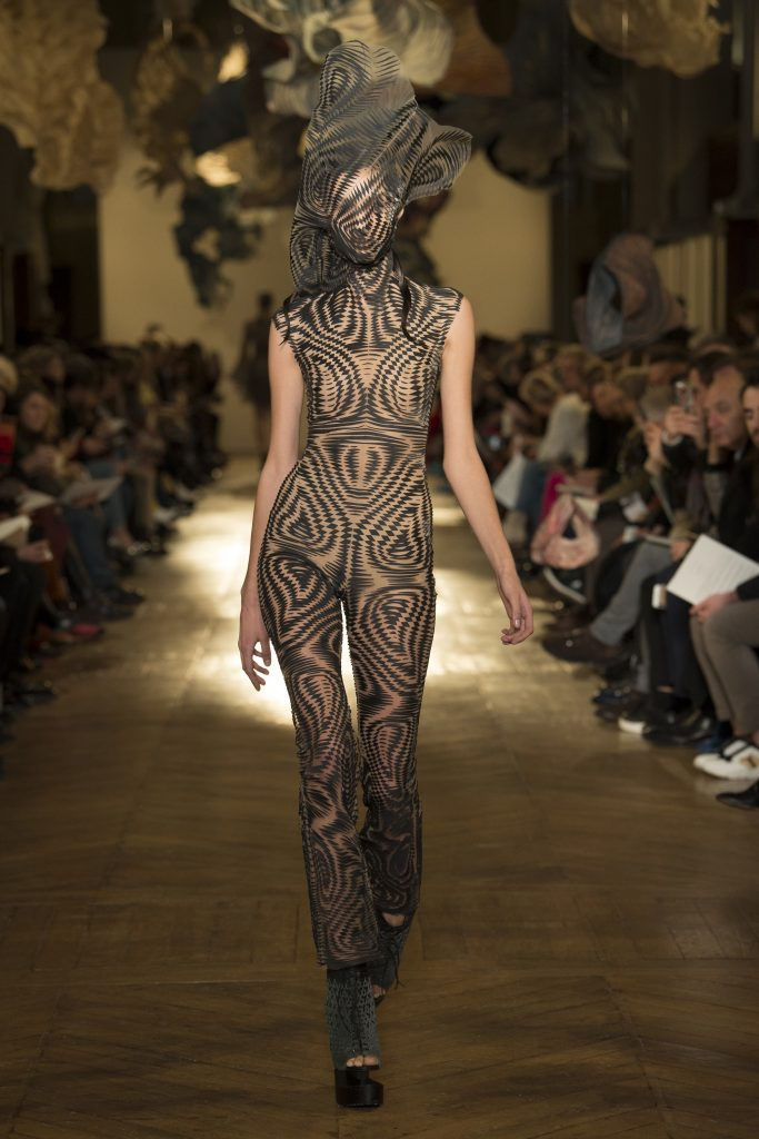 Made from 'Data Dust' a haute couture model walks down the runway in one of van Herpen's latest designs. Photo via Iris van Herpen