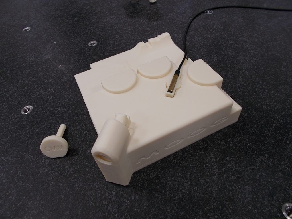A bespoke CMM fixture 3D printed for Moog. Photo via SYS Systems