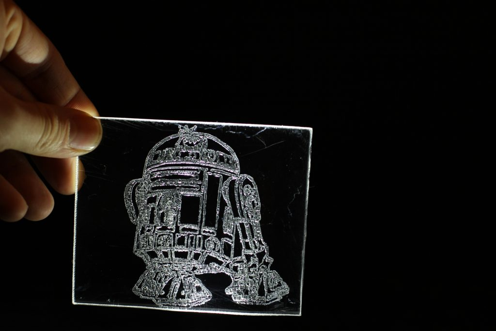 Laser engraving of R2D2 on acrylic. Photo via Endurance Lasers.