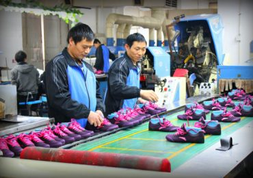 Part of a sneaker assembly line in a Chinese factory. Photo via ChinaB.org