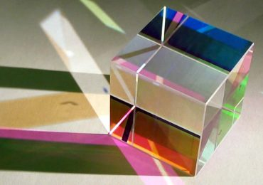 A beam splitting glass cube. Photo via Light Machinery