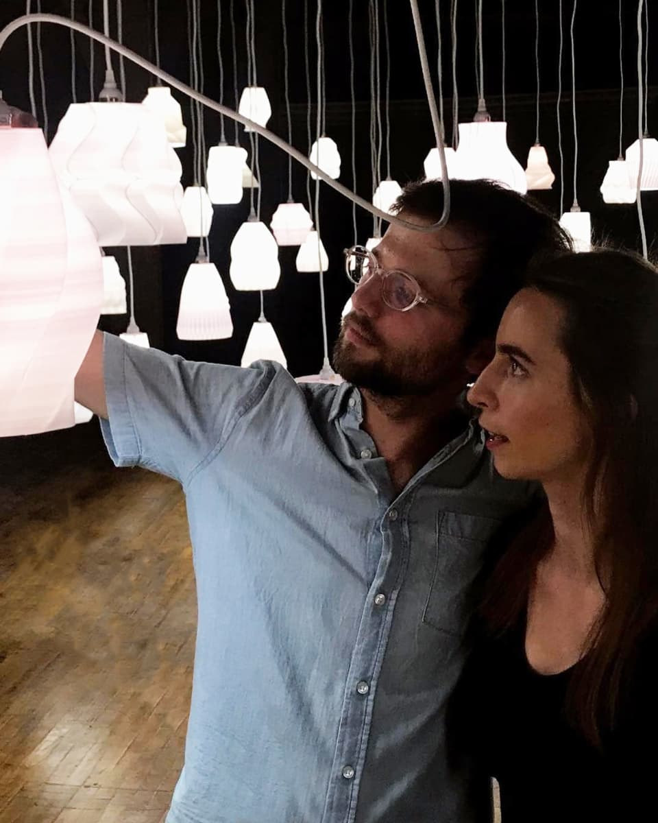 Founders of Budmen Industries, Isaac Budmen (L) and Stephanie Keefe (R) with the installation of 3D printed lamps. Photo via Budmen Industries.