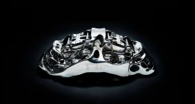 "Bugatti's ""world first"" SLM 3D printed brake caliper. Photo via Bugatti Automobiles S.A.S."